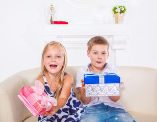 Brother and sister with presents