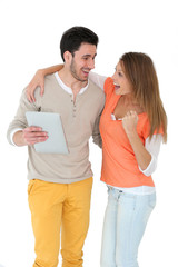 Cheerful couple using digital tablet, isolated