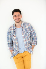 Trendy guy standing on white background