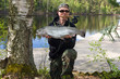 Angler with fly fishing trophy