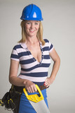 Female tradesperson wearing a hardhat poster