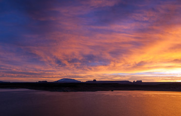 Beautiful classic sunrise over hills and Powell Lake, Arizona