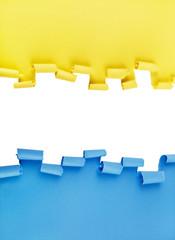 Blau-gelber gerissener Papier Hintergrund