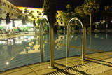 resort swimming pool late night - 64623290