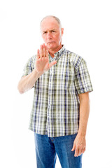 Senior man stopping with hand gesture