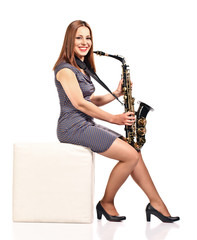 woman with saxophone isolated on white