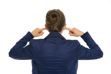 Business woman closing ears. rear view