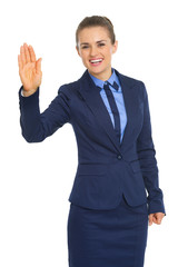 Portrait of happy business woman greeting