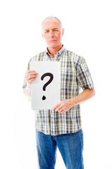 Senior man holding question mark sign