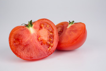 Halved ripe red fresh tomato