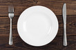 Empty plate, fork and knife - 64624640