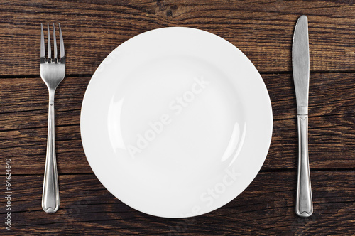 Fotobehang Situatie Empty plate, fork and knife
