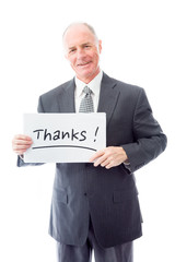 "Businessman holding a message board with the text words ""Thanks"""