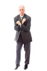 Businessman shivering in the cold isolated on white background