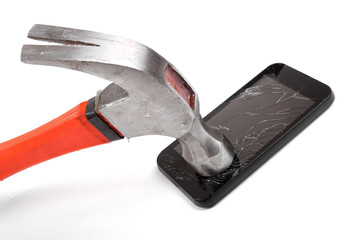 hammer and smartphone with smashed display