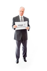 "Businessman holding a message board with the text words ""Vote"""