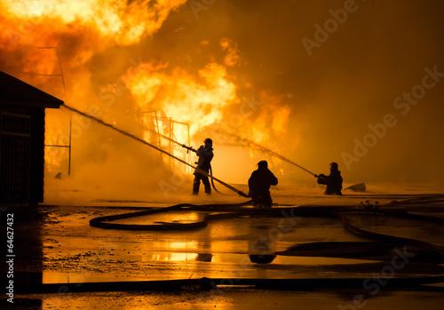 Firemen at work - 64627432