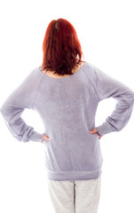 Rear view of a mature woman standing with her arms akimbo