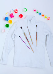 painting set and white turtleneck