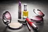 Fototapety Cosmetics on black slate background