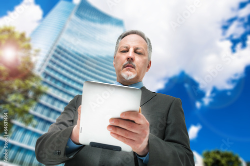Business man using a touchpad