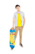 full length of a young man standing and holding a skateboard