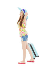 young female styled in summer outfit with travel baggage