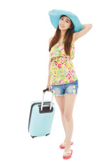 fashionable young female styled in summer outfit with baggage