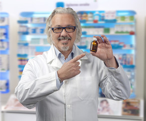 caucasian mature male pharmacist on bright background of a pharm