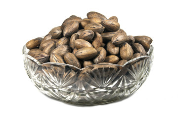 Decorative Glass Bowl Filled with Unshelled Pecan Nuts