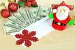 Dollar bills in envelope as gift at New year