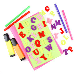 English alphabet, books and markers, isolated on white