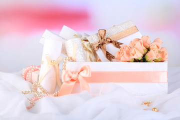 Beautiful handmade wedding cards in box, on light background