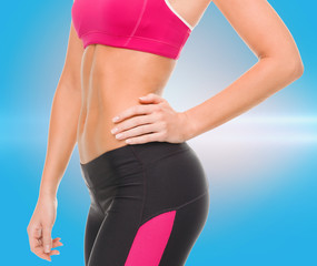 close up of female abs in sportswear