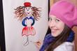 Girl artist draws a funny girl