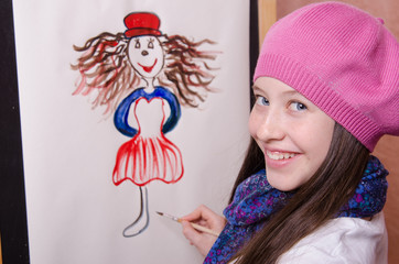 Girl artist draws a funny girl