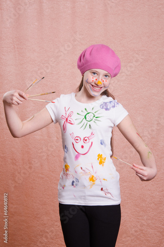 Painter girl in a decorated shirt