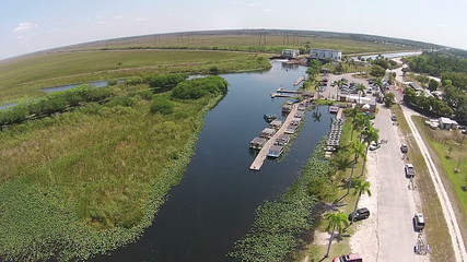 Everglades park with airboats for tourist rides aerial view