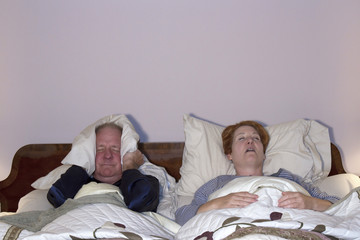 Man Dealing with Snoring Wife