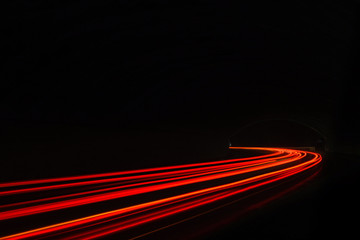 Car light trails in the tunnel.