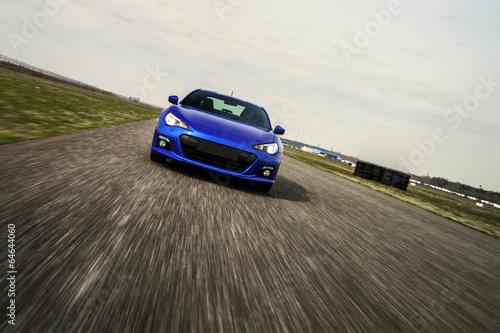 Foto op Plexiglas Motorsport Blue sport car on race way