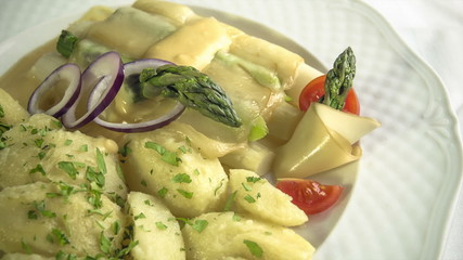 Asparagus baked with cheese served with buttered potatoes