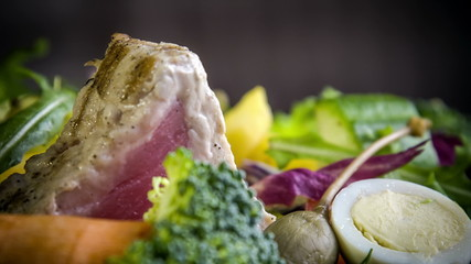 A variety of fresh and seasonal vegetables with grilled tuna