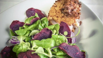 Chicken supreme baked breaded Pancho served  with beetroot chips
