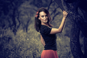 brunet woman at old tree