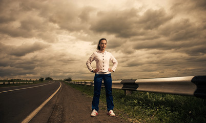 woman at stormy roadside