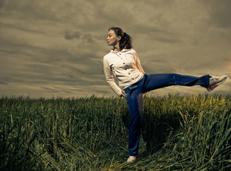 active woman at stormy field