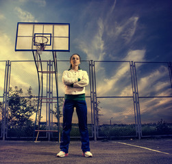 young sportive woman at basketball playground