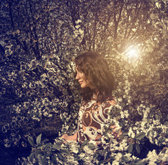 young woman at cherry tree branches