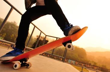 sunrise skateboarding woman